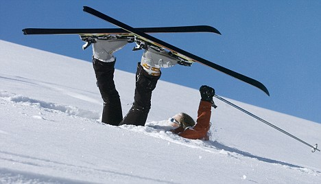 Fallen skier lying in powder snow